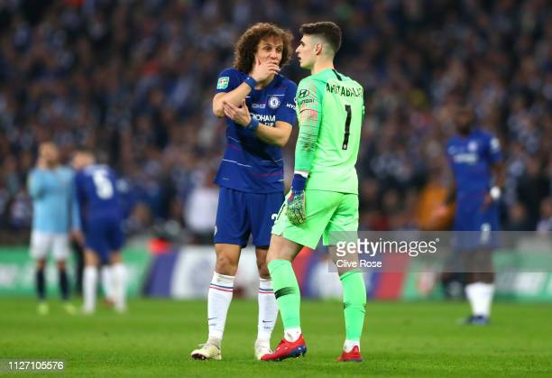Kepa Arrizabalaga of Chelsea speaks with David Luiz of Chelsea as he refuses to be substituted during the Carabao Cup Final between Chelsea and...