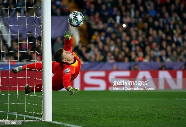 Kepa Arrizabalaga of Chelsea stops a penalty during the UEFA Champions League group H match between Valencia CF and Chelsea FC at Estadio Mestalla on...