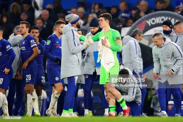 Kepa Arrizabalaga of Chelsea talks with teammate Willy Caballero at the end of 90 minutes during the Carabao Cup SemiFinal Second Leg match between...