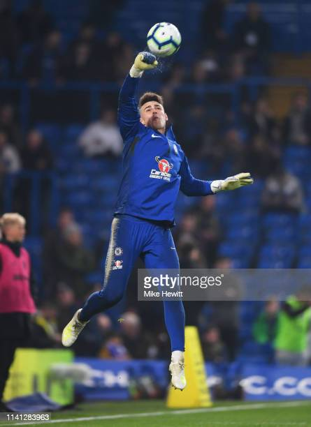 Kepa Arrizabalaga of Chelsea warm ups looks on prior to the Premier League match between Chelsea FC and West Ham United at Stamford Bridge on April...