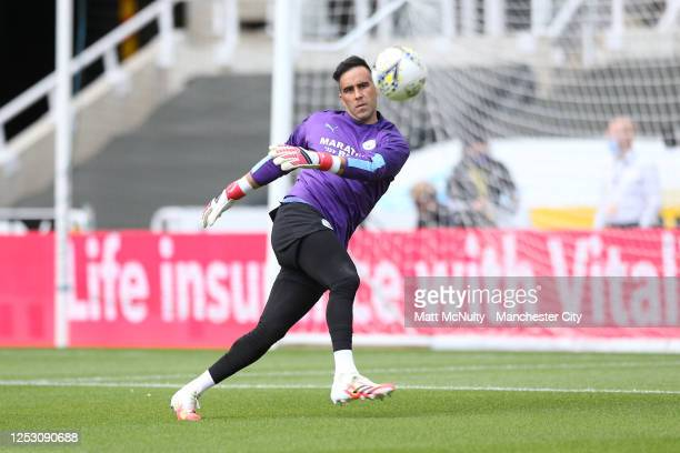Kepa Arrizabalaga of Chelsea warms up during the FA Cup Quarter Final match between Newcastle United and Manchester City at St James Park on June 28...