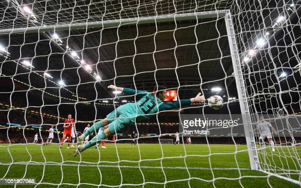 Kepa Arrizabalaga of Spain fails to stop Sam Vokes of Wales from scoring his team's first goal during the International Friendly match between Wales...