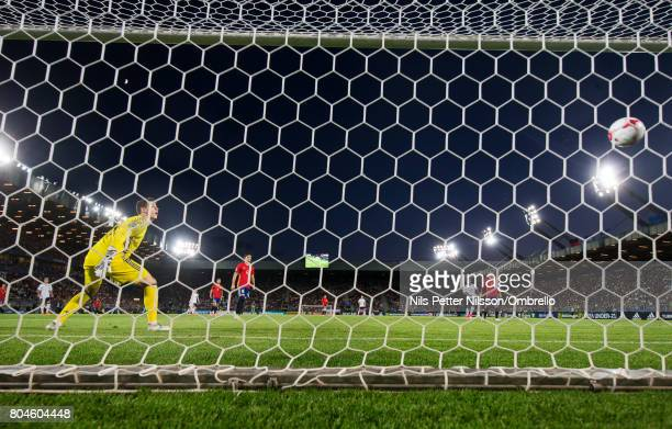 Kepa Arrizabalaga of Spain looks on as Mitchell Weiser of Germany scores the decisive goal to 10 during the UEFA U21 Final match between Germany and...