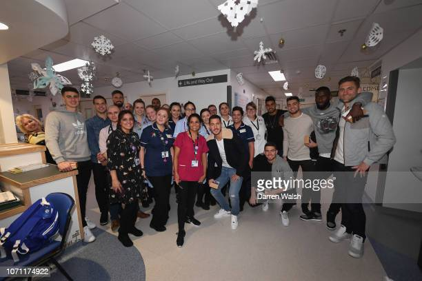 Kepa Arrizabalaga Olivier Giroud Eden Hazard Emerson Jorginho Cesar Azpilicueta Rob Green and Mateo Kovacic of Chelsea visit patients during a visit...