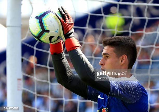 Kepa of Chelsea warms up prior to the Premier League match between Huddersfield Town and Chelsea FC at John Smith's Stadium on August 11 2018 in...