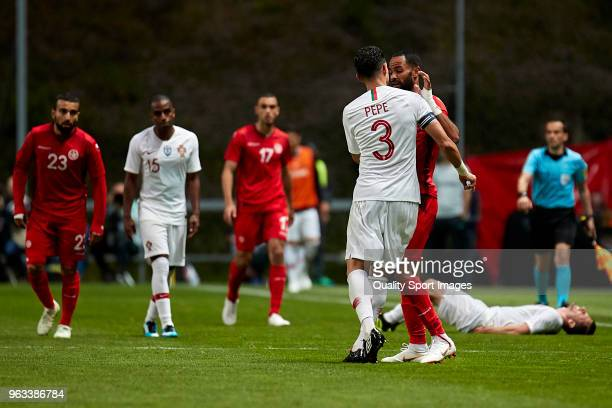 Kepler Laveran Lima 'Pepe' of Portugal push Saber Khalifa of Tunisia during the friendly match of preparation for FIFA 2018 World Cup between...