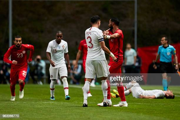 Kepler Laveran Lima 'Pepe' of Portugal pushes Saber Khalifa of Tunisia during the friendly match of preparation for FIFA 2018 World Cup between...
