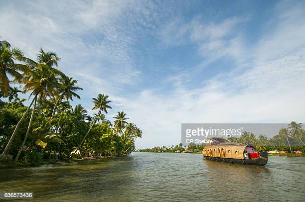 kerala backwaters tourism travel in canoe boat. kerala, india - kerala stock pictures, royalty-free photos & images