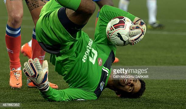 Kerala Blasters FC goalkeeper David James holds onto the ball after a save during the Indian Super League football match between Atletico de Kolkata...