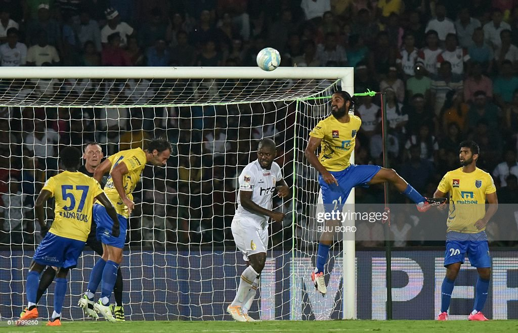 Kerala Blasters FC's defender Sandesh Jhingan (2R) heads the ball clear during the Indian Super League (ISL) football match between Northeast United FC and Kerala Blasters FC at The Indira Gandhi Athletic Stadium in Guwahati on October 1, 2016. USE-- / AFP / Biju BORO