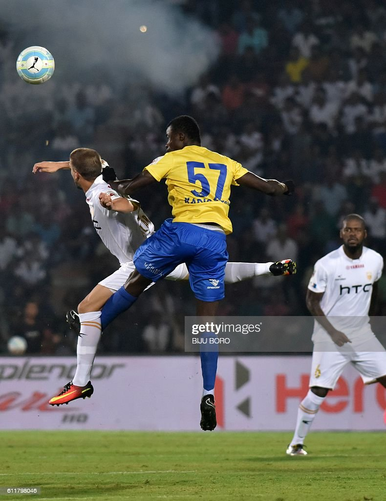 Kerala Blasters FC's midfielder Didier Boris Kadio (R) and Northeast United FC's forward Emiliano Alfaro fight for the ball during the Indian Super League (ISL) football match between Northeast United FC and Kerala Blasters FC at The Indira Gandhi Athletic Stadium in Guwahati on October 1, 2016. USE-- / AFP / Biju BORO