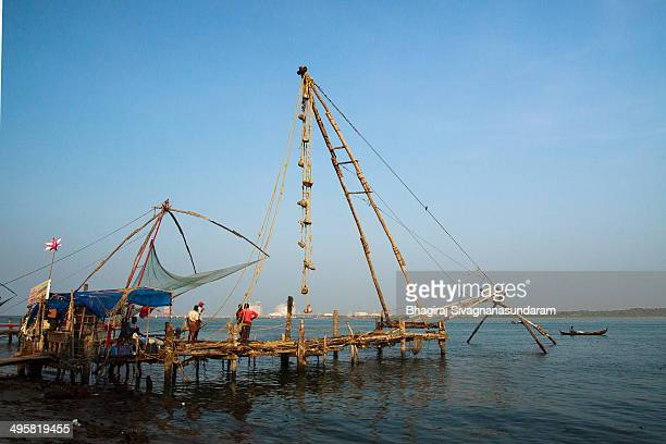 Kerala chinese fishing nets in fort kochi and kochi harbour at the background is a famous tourist and economical spot in Kerala - India.The nets were...