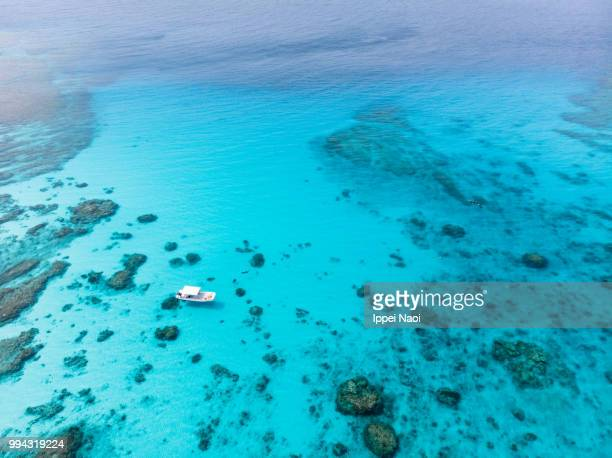 kerama islands national park with clear tropical water and boat from above, okinawa, japan - 沖縄県 ストックフォトと画像