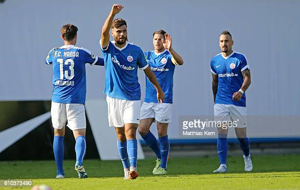 Kerem Buelbuel of Rostock jubilates after scoring the fourth goal during the third league match between FC Hansa Rostock and FSV Zwickau at...