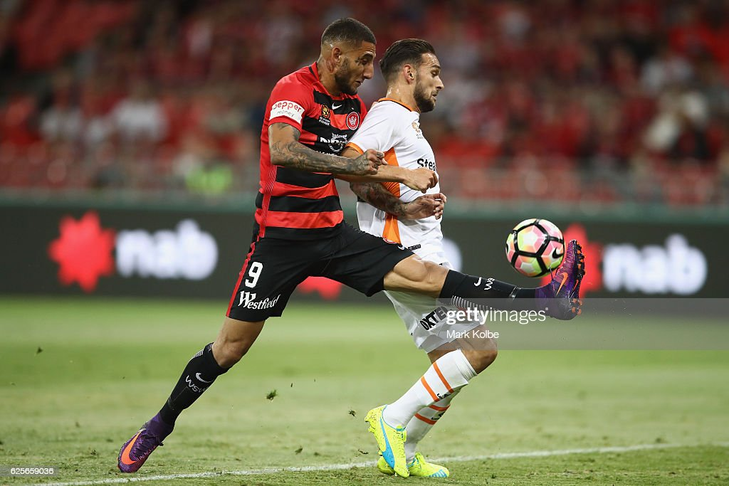 Kerem Bulut of the Wanderers misses a chance in front of goal under pressure from Brett Holman of the Roar during the round eight A-League match between the Western Sydney Wanderers and the Brisbane Roar at Spotless Stadium on November 25, 2016 in Sydney, Australia.