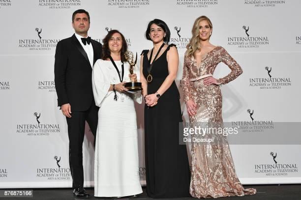 Kerem Catay winner of telenovela Kara Sevda and Presenter Carmen Aub poses in the press room at the 45th International Emmy Awards at New York Hilton...