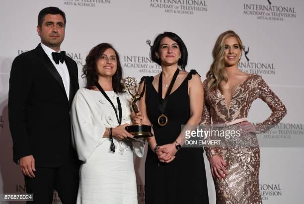 Kerem Catay winner of telenovela Kara Sevda and Presenter Carmen Aub at the 45th International Emmy awards gala in New York city on November 20 2017...