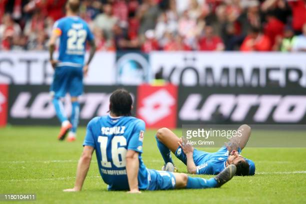 Kerem Demirbay and Nico Schulz of Hoffenheim react after JeanPaul Boetius of Mainz scored his team's second goal during the Bundesliga match between...