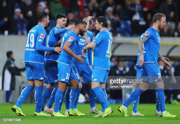 Kerem Demirbay of 1899 Hoffenheim celebrates after scoring his team's first goal with team mates during the Bundesliga match between TSG 1899...