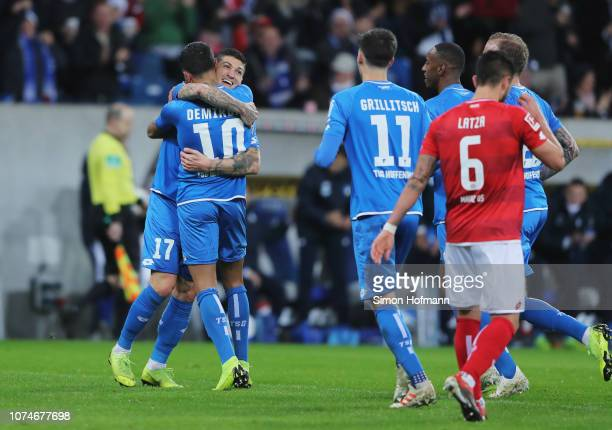 Kerem Demirbay of 1899 Hoffenheim celebrates after scoring his team's first goal with Steven Zuber and team mates during the Bundesliga match between...