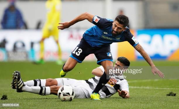 Kerem Demirbay of 1899 Hoffenheim is challenged by Mahmoud Dahoud of Borussia Moenchengladbach during the Bundesliga match between TSG 1899...
