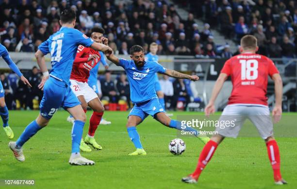 Kerem Demirbay of 1899 Hoffenheim scores his team's first goal with team mates during the Bundesliga match between TSG 1899 Hoffenheim and 1 FSV...