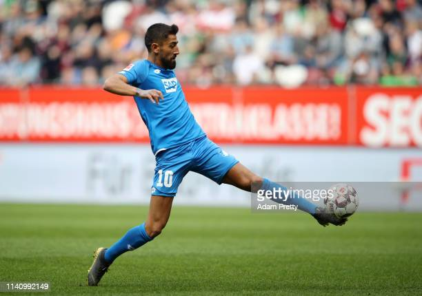 Kerem Demirbay of 1899 Hoffenheim stretches for the ball during the Bundesliga match between FC Augsburg and TSG 1899 Hoffenheim at WWKArena on April...