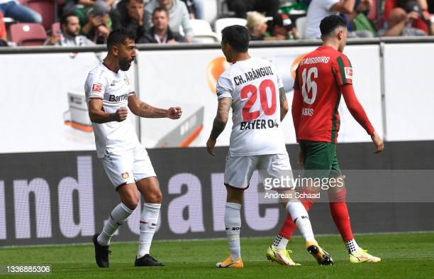 Kerem Demirbay of Bayer 04 Leverkusen celebrates after his team's second goal, an own goal by Florian Niederlechner of FC Augsburg during the...