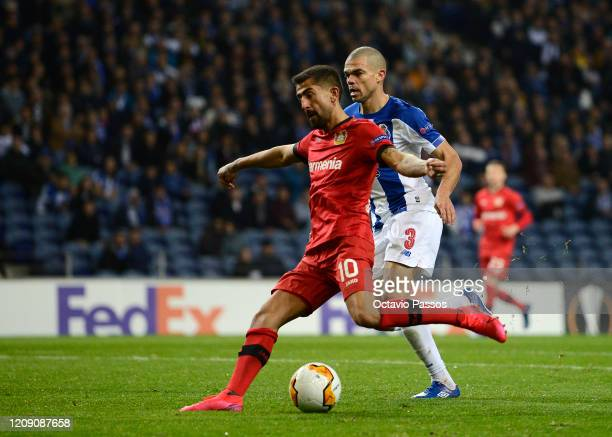 Kerem Demirbay of Bayer Leverkusen scores his sides second goal under pressure from Pepe of FC Porto during the UEFA Europa League round of 32 second...