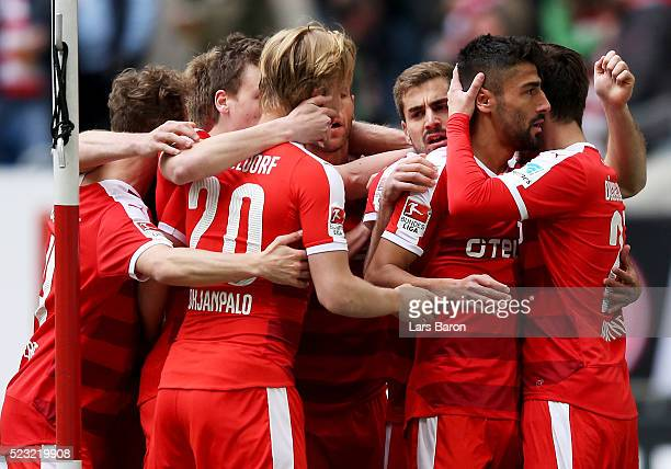Kerem Demirbay of Duesseldorf of Duesseldorf celebrates with team mates after scoring his teams first goal during the Second Bundesliga match between...