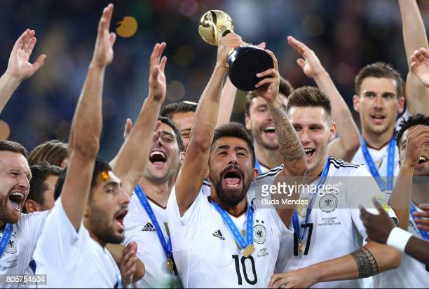 Kerem Demirbay of Germany lifts the FIFA Confederations Cup trophy after the FIFA Confederations Cup Russia 2017 Final between Chile and Germany at...