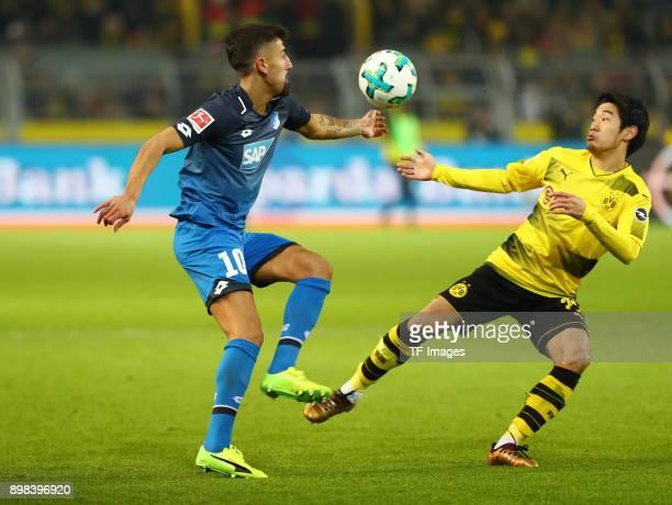 Kerem Demirbay of Hoffenheim and Shinji Kagawa of Dortmund battle for the ball during the Bundesliga match between Borussia Dortmund and TSG 1899...
