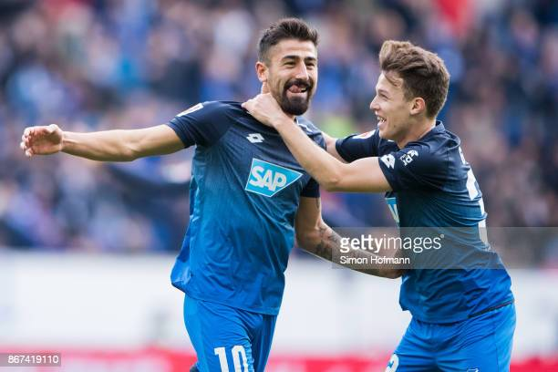Kerem Demirbay of Hoffenheim celebrates his team's first goal with team mate Dennis Geiger during the Bundesliga match between TSG 1899 Hoffenheim...
