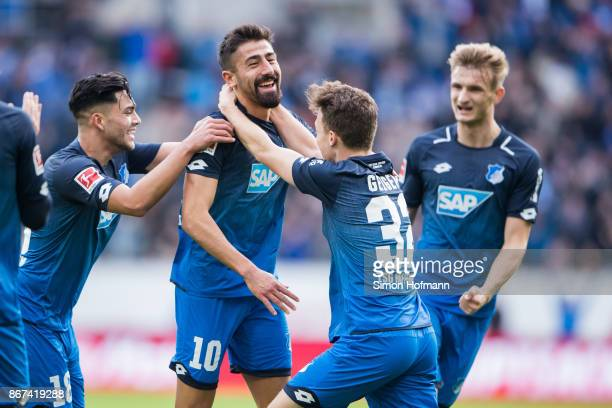 Kerem Demirbay of Hoffenheim celebrates his team's first goal with team mates Dennis Geiger Stefan Posch and Nadiem Amiri during the Bundesliga match...