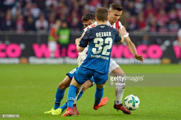 Kerem Demirbay of Hoffenheim Dennis Geiger of Hoffenheim and Pawel Olkowski of FC Koeln battle for the ball during the Bundesliga match between 1 FC...