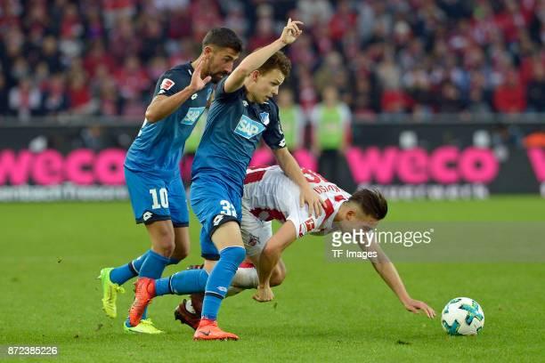 Kerem Demirbay of Hoffenheim Dennis Geiger of Hoffenheim and Pawel Olkowski of FC Koeln battle for the ball during the Bundesliga match between 1 FC...