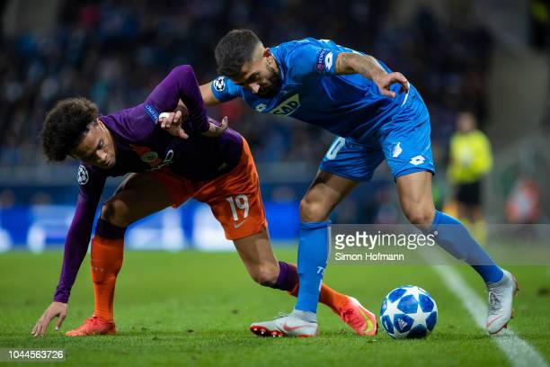 Kerem Demirbay of Hoffenheim is challenged by Leroy Sane of Manchester City during the Group F match of the UEFA Champions League between TSG 1899...