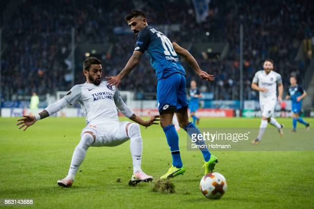 Kerem Demirbay of Hoffenheim is tackled by Junior Caicara of Istanbul during the UEFA Europa League group C match between 1899 Hoffenheim and...