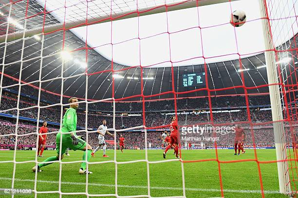 Kerem Demirbay of Hoffenheim scores his team's first goal past Goalkeeper Manuel Neuer of Muenchen during the Bundesliga match between Bayern...