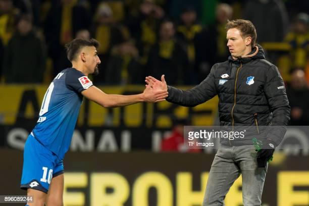 Kerem Demirbay of Hoffenheim shakes hands with Head coach Julian Nagelsmann of Hoffenheim after the Bundesliga match between Borussia Dortmund and...