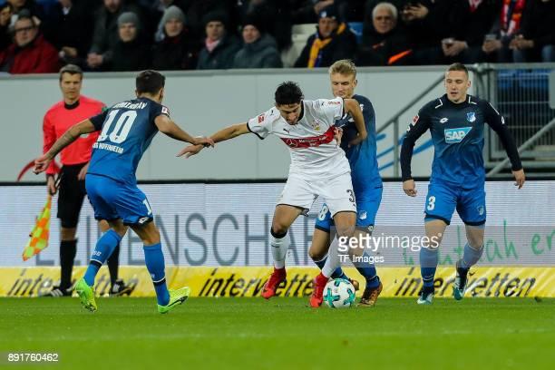 Kerem Demirbay of Hoffenheim Stefan Posch of Hoffenheim and Berkay Oezcan of Stuttgart battle for the ball during the Bundesliga match between TSG...
