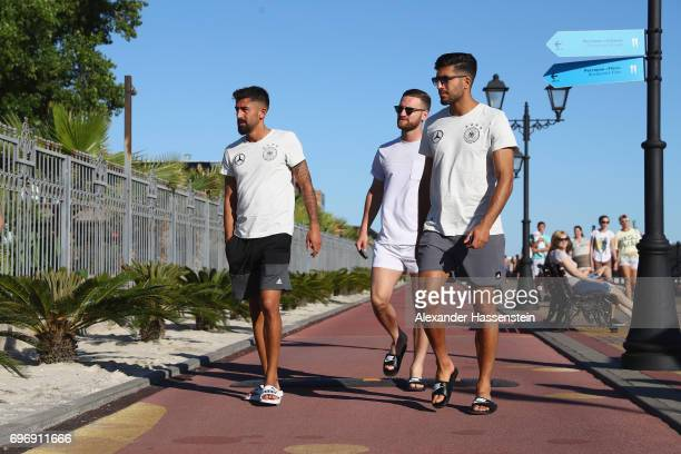 Kerem Demirbay Shkodran Mustafi and Emre Can of the German national team walks outside the team hotel Radisson Blu Paradise Resort Spa at Adler Beach...