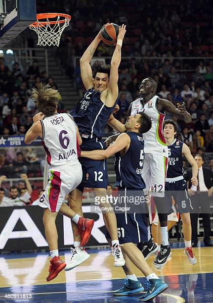 Kerem Gonlum, #12 of Anadolu Efes Istanbul competes with Giuseppe Poeta, #6 of Laboral Kutxa Vitoria in action during the 2013-2014 Turkish Airlines...