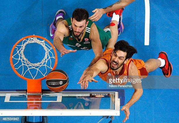 Kerem Gonlum, #12 of Galatasaray Liv Hospital Istanbul competes with Antonis Fotsis, #9 of Panathinaikos Athens during the Euroleague Basketball Top...