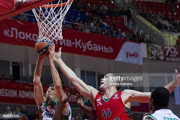 Kerem Gonlum #21 of Pinar Karsiyaka Izmir competes with Kyrylo Fesenko #44 of Lokomotiv Kuban Krasnodar during the Turkish Airlines Euroleague...