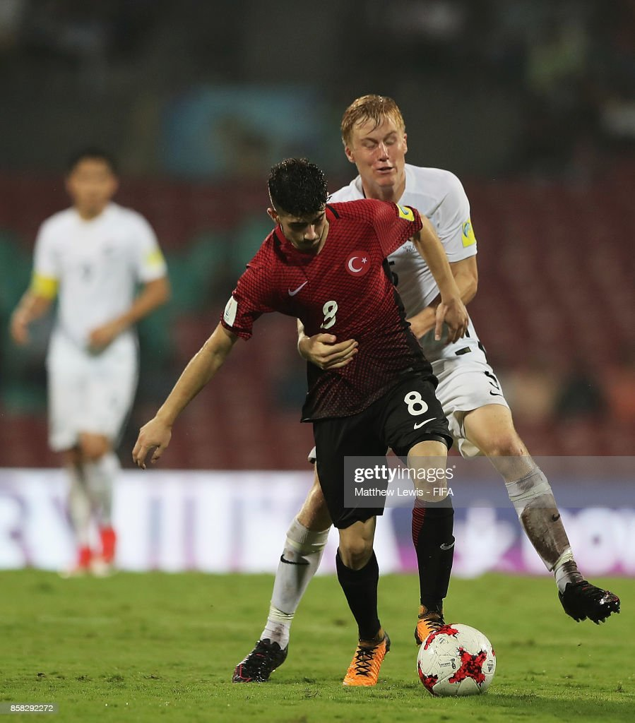 Kerem Kesgin of Turkey and Boyd Curry of New Zealand challenge for the ball during the FIFA U-17 World Cup India 2017 group B match between New Zealand and Turkey at Dr DY Patil Cricket Stadium on October 6, 2017 in Mumbai, India.