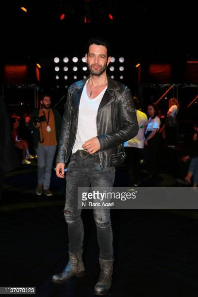 Keremcem attends the MercedesBenz Fashion Week Istanbul March 2019 at Zorlu Center on March 20 2019 in Istanbul Turkey