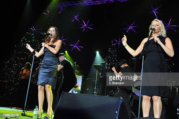 Keren Woodward and Sara Dallin of Bananarama perform on stage at the Hit Factory Live Christmas Cracker at 02 Arena on December 21 2012 in London...