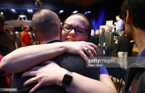 Keri Bean NASA Tactical Uplink Lead for the rover Opportunity hugs a colleague at a press conference announcing the conclusion of the Opportunity...