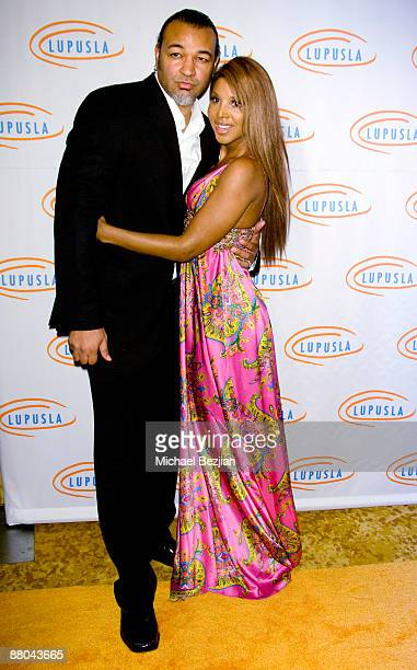 Keri Lewis and recording artist Toni Braxton arrive at the 9th Annual Lupus LA Orange Ball at the Beverly Wilshire Four Seasons Hotel on May 28 2009...